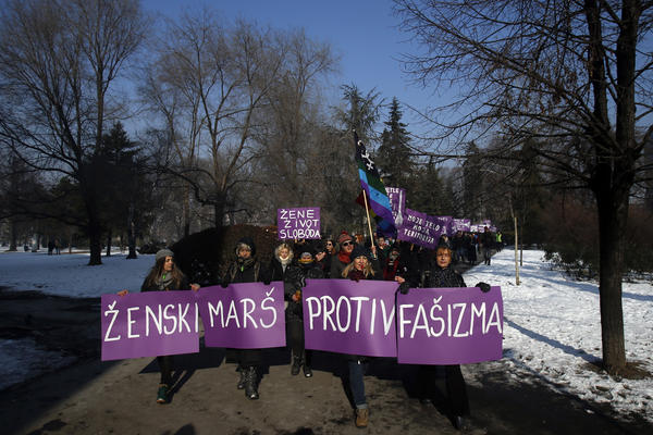 "Activists hold a banner that reads ""Women's March Against Fascism"" during the Women's March rally in Belgrade, Serbia, on Saturday."