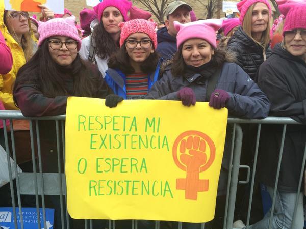 Erika Abril (R) and daughters Maria Emilia Proano, 18 (L) and Maria Paula Proano, 16 (Center) at the Women's March Saturday.