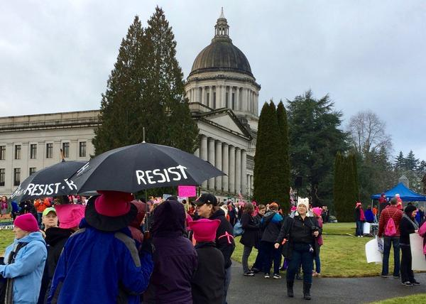 Demonstrators gather near the capitol in Olympia for one of dozens of women's marches in the Northwest Saturday.