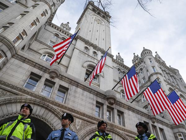 Police stand guard outside the Trump International Hotel in Washington the day before the inauguration. The president's business interest in a government-owned property has drawn criticism from Democrats and some ethics advisers.