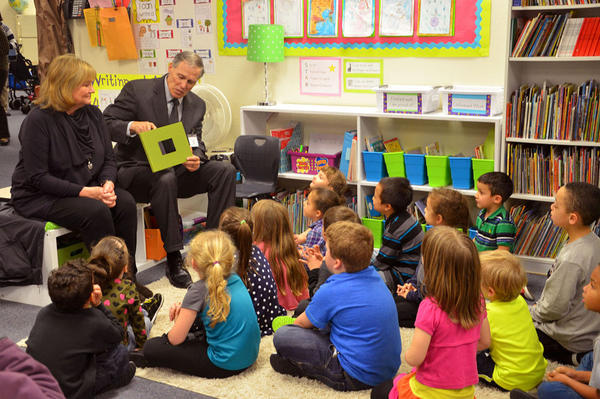 File photo of Gov. Jay Inslee and first lady Trudi Inslee at a kindergarten class at an elementary school in Yelm, Washington, in 2015.