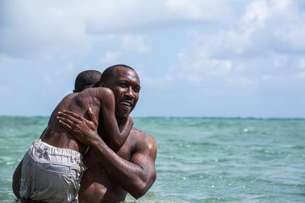 Mahershala Ali holds Alex Hibbert in the film, <em>Moonlight</em>. Ali was nominated for an Oscar for supporting actor.