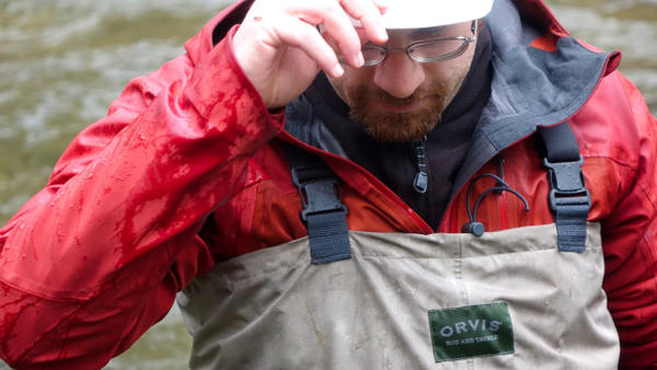 <p>OSU's Kevin Weitemier takes a break between collecting water samples in a stream. </p>