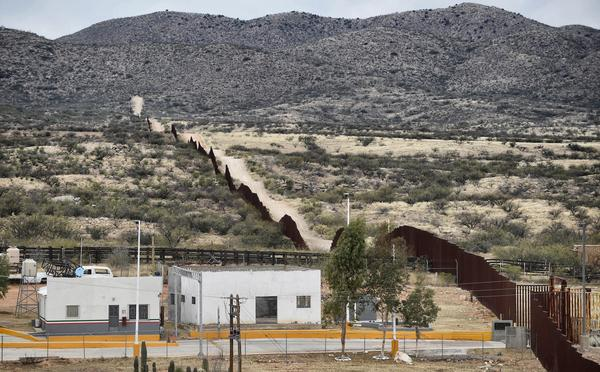 President Trump has signed an order to begin building a new wall along the border between Mexico and the U.S. Here, the border is seen from the community of Sasabe in Sonora state, Mexico, earlier this month.