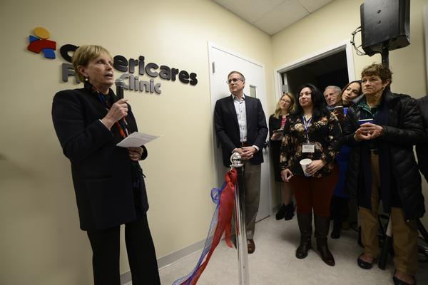 Karen Gottlieb, executive director of Americares' Free Clinics program, speaks at the opening of the group's fourth Fairfield County clinic on Wednesday.