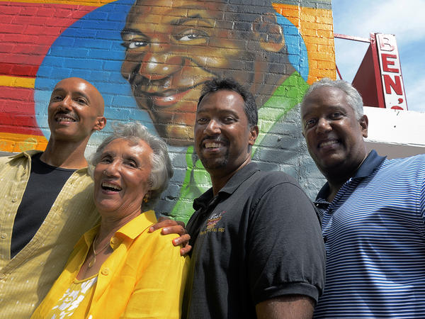 Virginia Ali, matriarch of the Ali family, of Ben's Chili Bowl, with her sons Sage (from left), Nizam and Kamal on the eve of their 55th-anniversary celebration, Aug. 21, 2013.