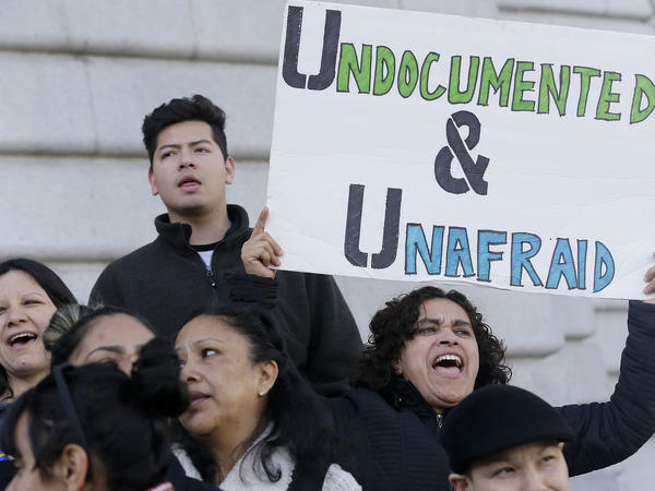 Lordes Reboyoso yells at a rally outside of City Hall in San Francisco to protest President Donald Trump's aggressive moves to tighten the nation's immigration controls. A new study showed that sanctuary cities like San Francisco are safer and have stronger economies.