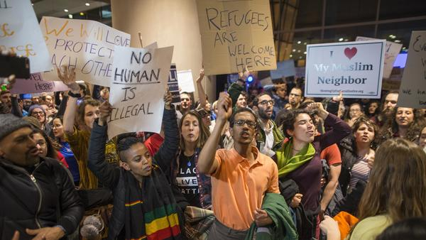 Protesters at Logan International Airport in Boston Saturday