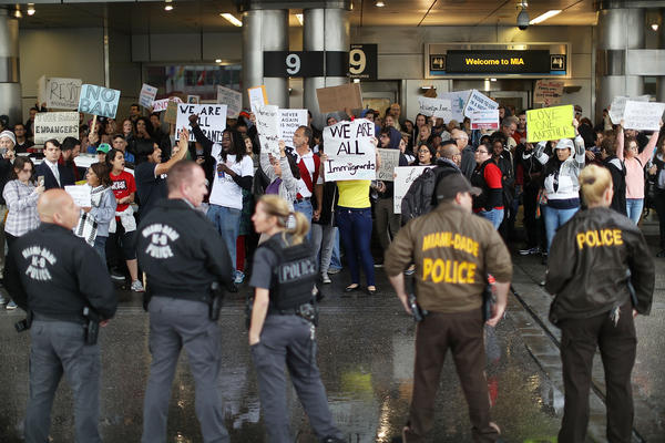 Protesters at the Miami International Airport rally against the president's executive order regarding immigration.