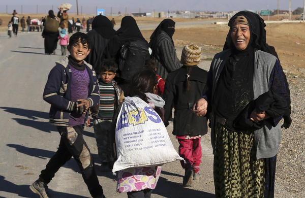 Iraqi civilians return to their neighborhoods in the eastern side of Mosul on Tuesday after the Islamic State was driven out. The extremist group still controls the western side of the city.
