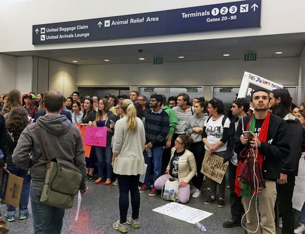 Demonstrators block an exit at the international terminal as they protest against President Donald Trump's executive order banning travel to the U.S. by citizens of several countries at San Francisco International Airport on Sunday.