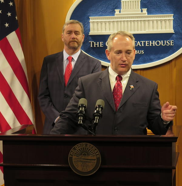 State Auditor Dave Yost stands behind former Senate President and now Rep. Keith Faber at a press conference in April 2016.