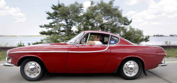 Irv Gordon in his Volvo P1800S.