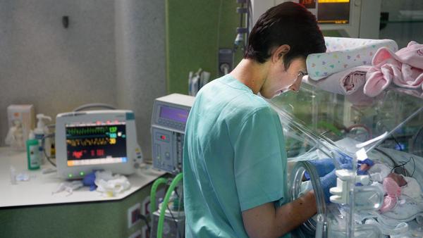 Nurse Carina Araujo gives care to a child in the neonatal intensive care unit at Maternidade Doutor Alfredo da Costa Hospital in Lisbon, Portugal, on June 6. Portugal's birthrate has dropped 14 percent since the economic crisis hit.