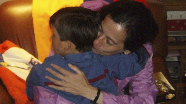 Clara Rojas embraces her son, Emmanuel, at a foster center in Bogota on Jan. 13, 2008. He had been taken from his mother by the guerrillas holding her, and they were apart for three years until her release.
