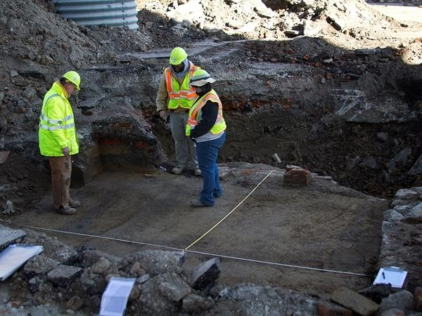 Archaeologists survey a dig site just south of the St. Louis' famed Gateway Arch. Artifacts found there date back to the 18th century.