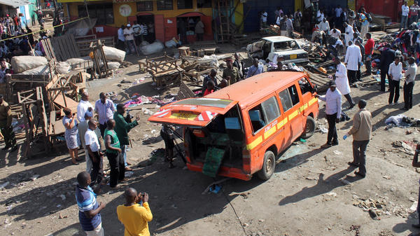 "Security officers patrol the scene of an explosion aboard a minibus in the Gikomba market area of Nairobi, Kenya, on May 16. The Kenyan capital was hit by two explosions that day --€"" a day after Western tourists were evacuated from Mombasa."