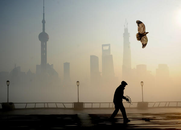 A man flies a kite Dec. 5 at the Bund in Shanghai.