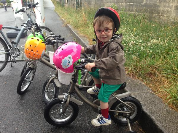 Not quite 3 years old, Oscar Bayeda is just learning to ride with the help of P'tit Velib's bike-sharing program for children.