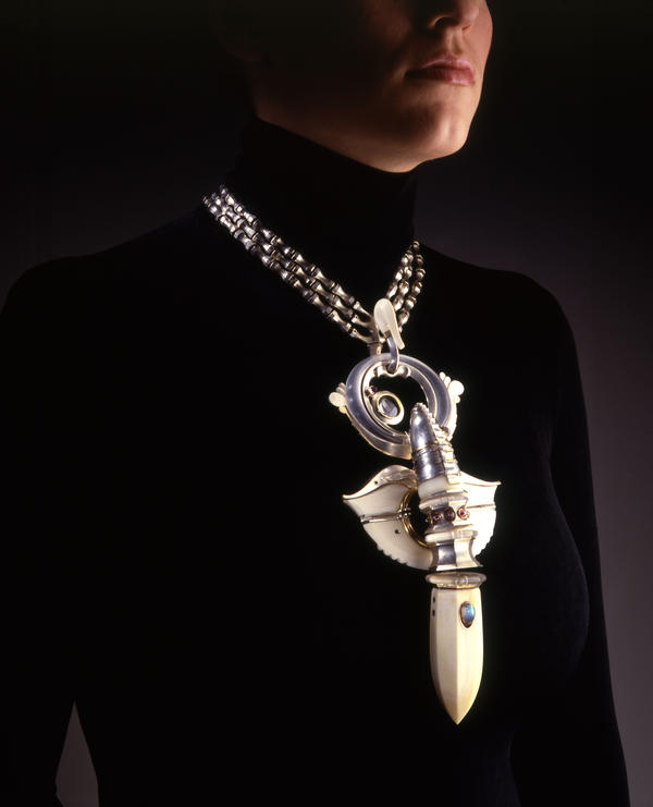 "Paley started out as a jeweler — but wasn't making dainty lapel pins. ""The feminist movement had started,"" he says, and his designers were not ""for a meek, demure woman."" Above, Paley's 1973 pendant, made from silver, ivory, plexiglass, copper, gold, amethyst beads, glass lens, opal, moonstone and amethyst crystal."