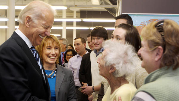 Vice President Joe Biden, accompanied by New Hampshire Gov. Maggie Hassan, greets Enis Sullivan, 101, during a visit to XMA Corp. in Manchester, N.H., on March 25.