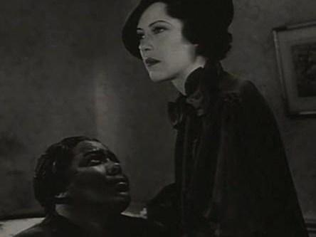 A scene from <em>Imitation of Life</em>, a 1934 film starring Fredi Washington playing a black woman who passes as white.