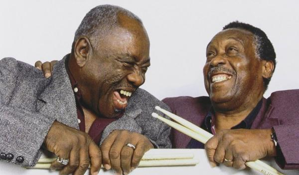 "John ""Jabo"" Starks (left) and Clyde Stubblefield laid the grooves on many of James Brown's biggest hits. Here, they clown around on the cover of their joint DVD, <em>Soul of the Funky Drummers</em>."