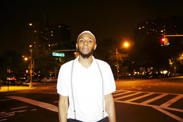 Yasiin Bey (formerly known as Mos Def), former Roosevelt Houses resident. He is a hip-hop artist and actor who has appeared on Broadway (<em>Topdog</em>/<em>Underdog</em>), television (Showtime's <em>Dexter</em>), and in film (<em>Monster's Ball</em>, <em>Be Kind Rewind</em>, <em>Cadillac Records</em>). This photo was taken in front of the Farragut Houses in the Brooklyn neighborhood of Dumbo.
