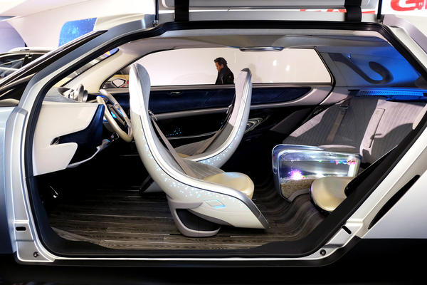 Chinese automaker GAC Group's WitStar concept autonomous electric car features a fish tank armrest in the back seat.