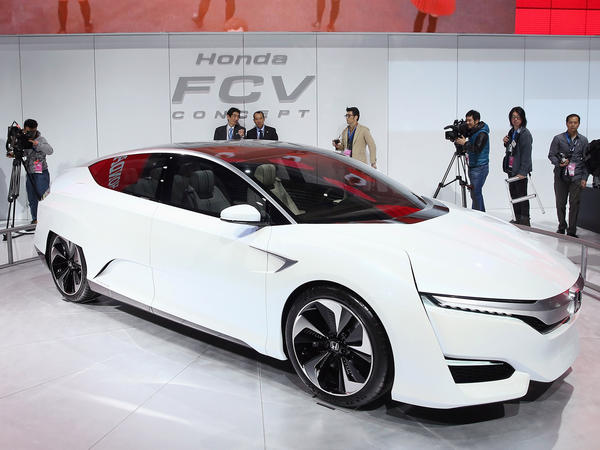 Guests look over the Honda FCV fuel-cell-powered concept car during the media preview at the North American International Auto Show in Detroit.