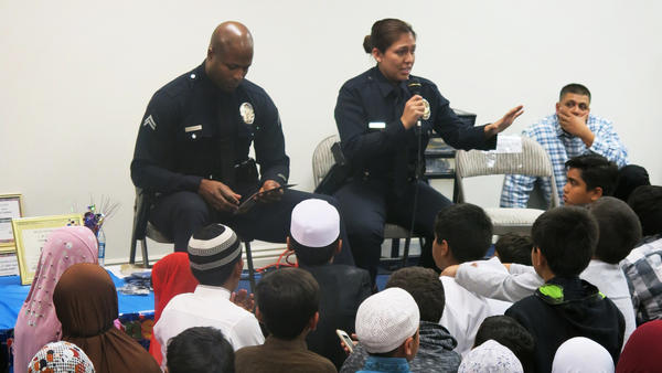 Shawn Alexander and Ashley Jimenez visit a madrassa in the Los Angeles area. The two police officers are part of the Los Angeles Police Department's counterterrorism bureau, which is focused on fostering community engagement.