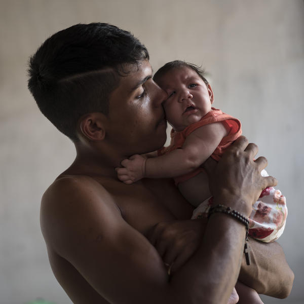 Dejailson Arruda holds his daughter, Luiza, at their house in Santa Cruz do Capibaribe, Pernambuco state, Brazil, in this December 2015 photo. The child was born with microcephaly.