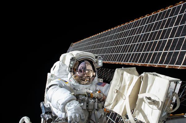 NASA astronaut Scott Kelly works outside the International Space Station during a spacewalk last year.