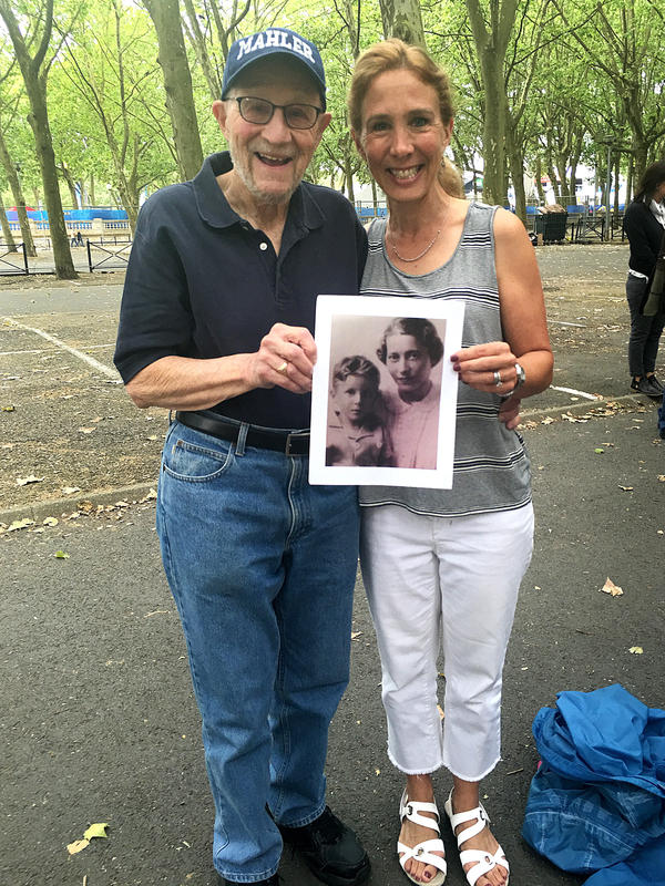 Stephen Rozenfeld and daughter Leah Sills were among those gathered to honor Sousa Mendes' memory. Rozenfeld holds a photograph showing him and his mother when he was 5, when he and his family received Portuguese visas and fled France.