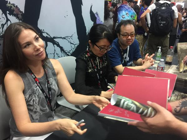 Marjorie Liu signs copies of <em>Monstress</em> at San Diego Comic-Con.