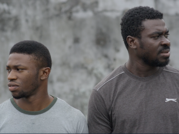 Duke (Stan Nze, left) and Victor (Obutu Roland, right) in <em>Just Not Married</em>.