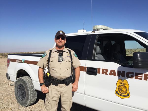 Bureau of Land Management Ranger Shane Nalen stands on public land that he patrols outside of Las Vegas, Nev.