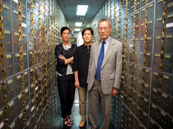 From left to right: Vera Sung, Jill Sung and Thomas Sung in the documentary <em>Abacus: Small Enough to Jail.</em>