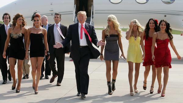 Donald Trump (center) and female WWE performers attend a press conference on June 22, 2009, in Green Bay, Wis.
