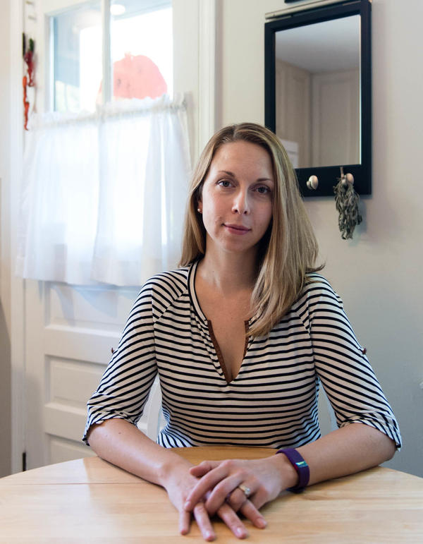 """Meg Whitbeck, 34, at her home in Ridgefield, Conn. She says she is grateful for orphan drugs but torn on the issue of price. """"Why can't they make it a little less expensive?"""" she asks. """"What's holding them back?"""""""