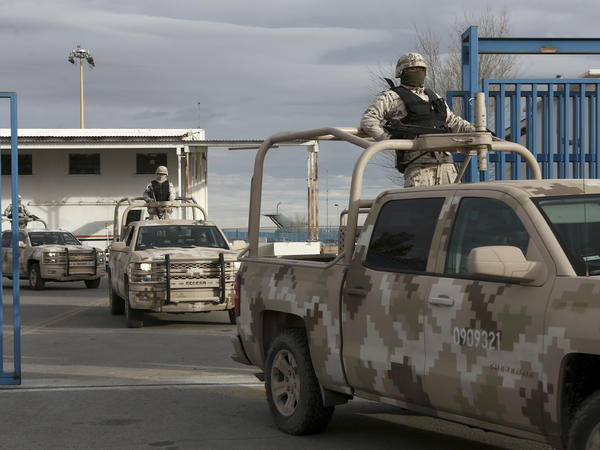 "Mexican soldiers leave the airport in Ciudad Juarez, Mexico, after authorities handed over drug lord Joaquin ""El Chapo"" Guzman to U.S. officials."