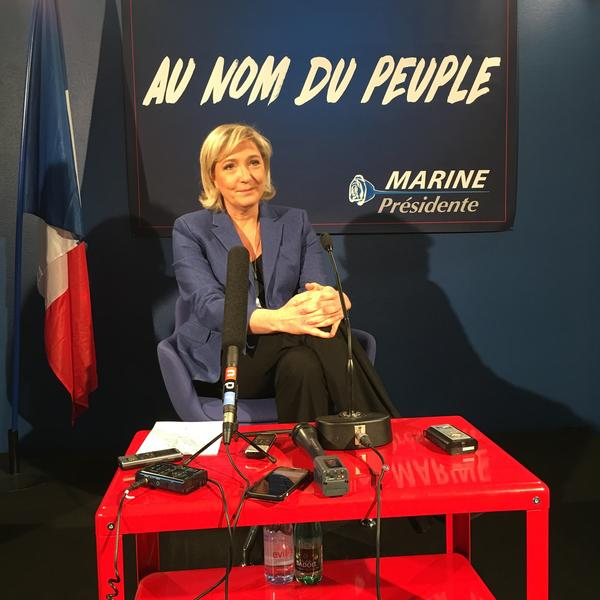 Marine Le Pen speaks to reporters in her campaign headquarters.