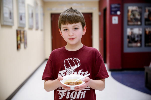Gabe Schenk, 12, says the secret to cooking is that you have to talk to your food.