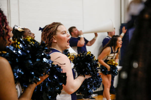 Cheerleaders encourage the Independence Community College Pirates as they play the Coffeyville Red Ravens.