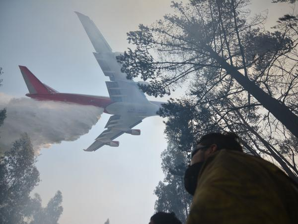 A Boeing 747 firefighting plane helps put out a forest fire in Concepcion, Chile, on Saturday.