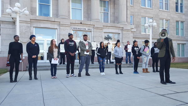 Roughly 20 students protested in front of MSU's Carrington Hall Monday afternoon calling for the dismissal of Juan Meraz.