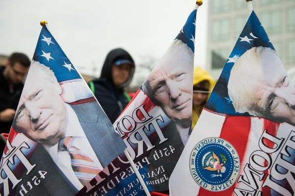 Flags printed with President Trump's face are sold outside one of the entrances to the National Mall in Washington, D.C., on Inauguration Day on Jan. 20.