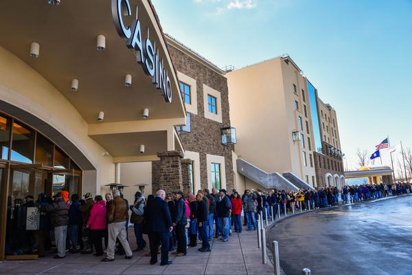 People wait in line to attend the grand opening of the del Lago casino in Tyre.