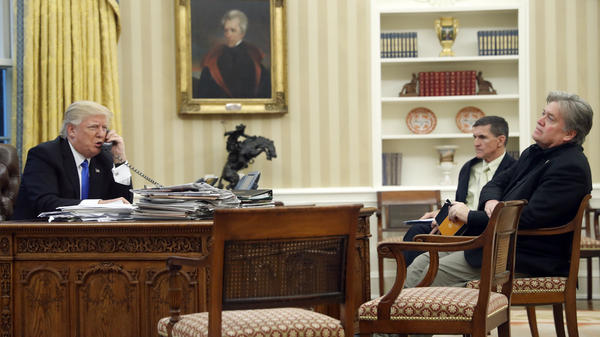 President Trump speaks on the phone with Australian Prime Minister Malcolm Turnbull, with national security adviser Michael Flynn (center) and chief strategist Steve Bannon in the Oval Office of the White House on Saturday.