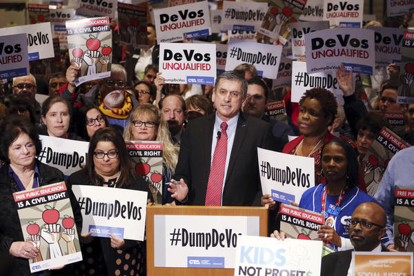 California Teachers Association President Eric Heins speaks as California educators voice their opposition to President Trump's nomination of Besty DeVos for secretary of education, at a meeting in Los Angeles on Jan. 28.